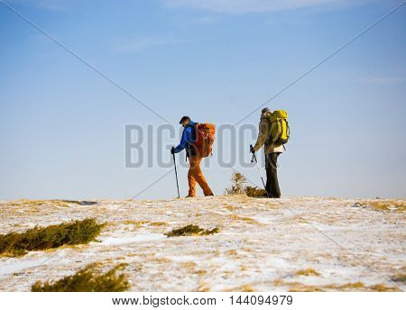 Tourists Hiking In The Mountains.