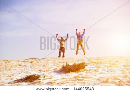 Climbers Jumping For Joy.