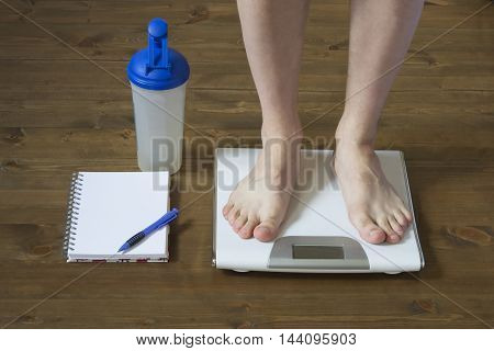 Weighing on the floor before standing in front of weights