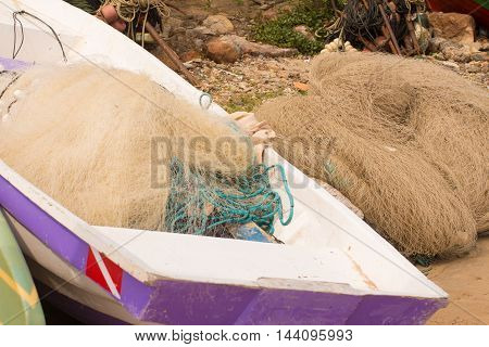 Fishing Net in the boat on the beach
