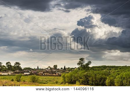 beautiful storm clouds are over rural houses