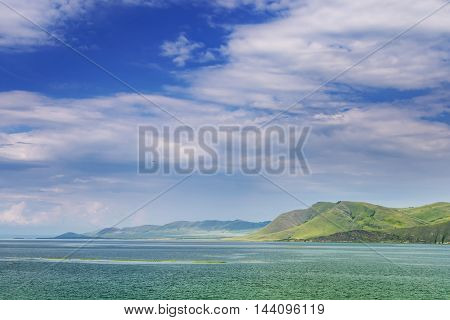 summer landscape with the river and a mountain ridge