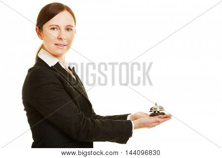Female concierge holding a hotel bell in her hands