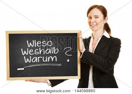 Business woman holding chalkboard with German words