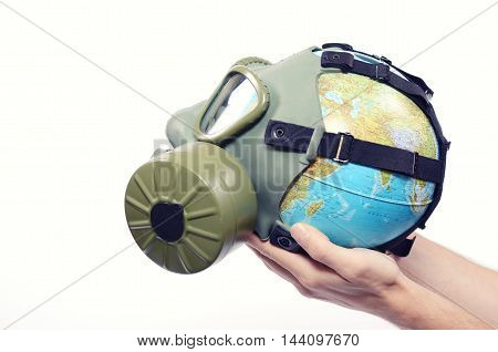 Global Earth and environmental pollution concept Globe with gas mask isolated