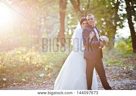 Young Stylish Wedding Couple At Sunset