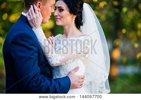 Close Up Portrait Of Young Stylish Weding Couple On Sunset