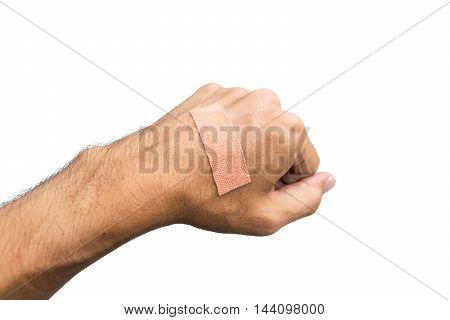 Closeup plaster bandage on a hand isolated on white background.