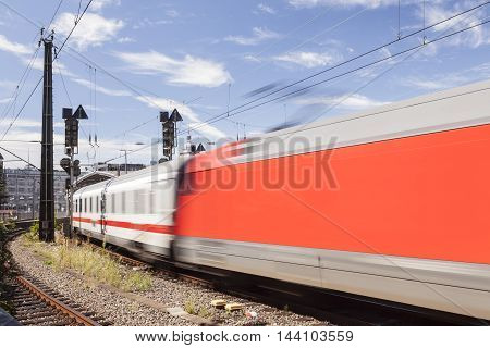 Red passenger train at the Central Station in Cologne North Rhine-Westphalia Germany
