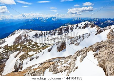 Panoramic view from the height of bird's flight over the mountain ranges and clouds. Picture was taken during trekking hike in the magnificent Caucasus mountains Lago-Naki region Adygeya Russia