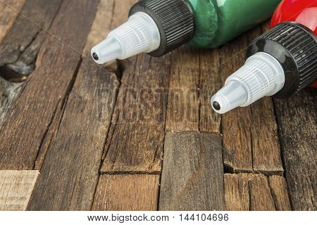 Bottles with colorful pigments on wooden background. Stock image macro.