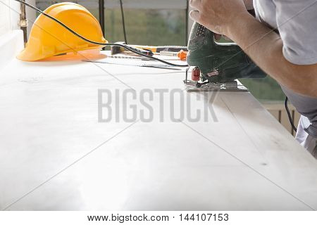 Cutting with Electric Saw with Copy Space