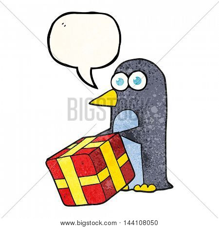 freehand speech bubble textured cartoon penguin with christmas present