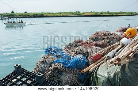 Fishing nets piled in a row on the pier