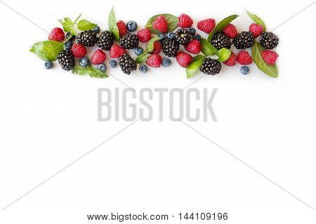 Various fresh summer berries isolated on white. Ripe blueberries, raspberries and blackberries.