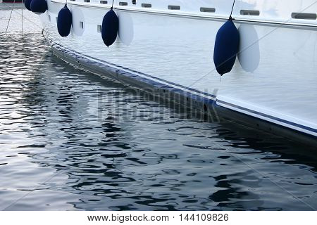 yacht floats detail on water with reflections