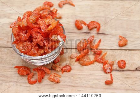 dried shrimp  in  glass  bowl on wooden  background