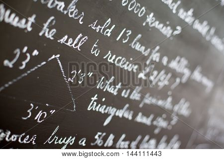 A vintage blackboard with writing in a school classroom
