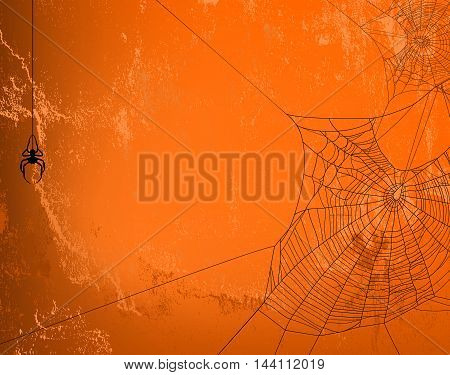 Spider web silhouette against orange wall - halloween theme spooky background with place for your text