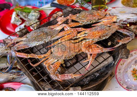 Close-up of grilling  fresh crabs  on charcoal grill