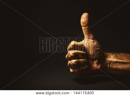 Man's hand showing that everything is all right.