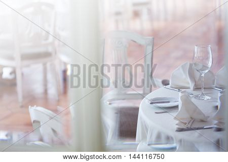 View through the glass at the restaurant. Interior in white tones