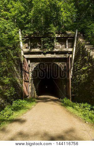 A bike trail passing through a former railroad tunnel.