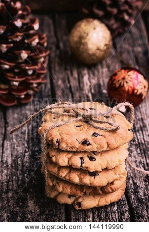 Stack of Chocolate Chip Cookies on a Wooden Table, Toned Image, Christmas Sweets. Style Rustic.