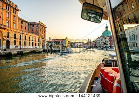 Venice, Italy - May 18, 2016: View from the Vaporetto on the way on Gand canal in the morning. Vaporetto is popular water taxi among tourists and residents in Venice