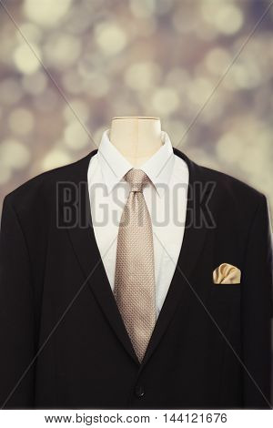 Close up of a man's suit and tie with white shirt and gold colored handkerchief