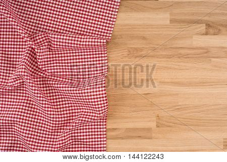 the checkered tablecloth on wooden table. Top view.