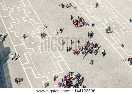 Venice, Italy - May 18, 2016: Top view on San Marco square crowded with tourists. This square is the most popular place among tourists in Venice