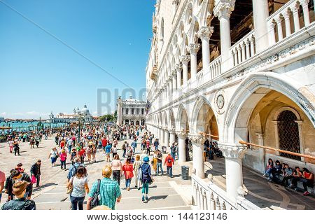 Venice, Italy - May 18, 2016: View on Doges palace with crowded with tourists square in Venice.