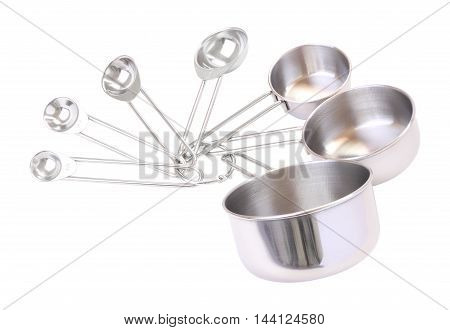 Series of measuring spoons on white background.