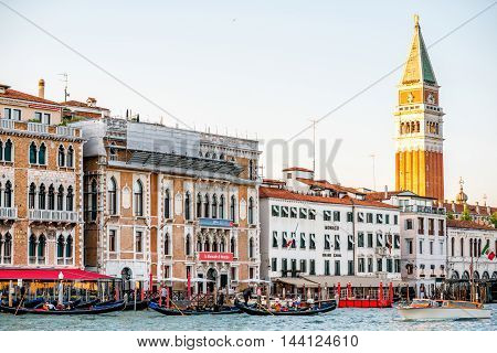 Venice, Italy - May 18, 2016: Sunset view on San Marco campanille with gothic buildings on Grand canal in Venice