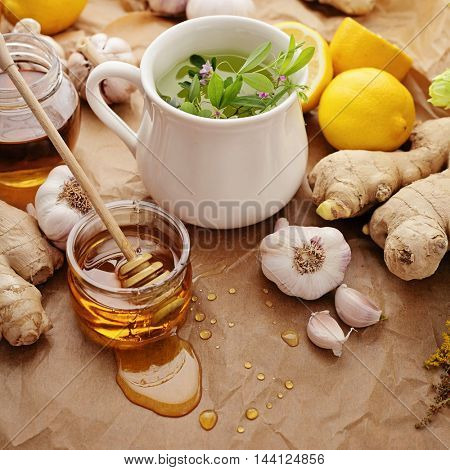 healthy tea with herbs, honey, ginger, garlic and lemon