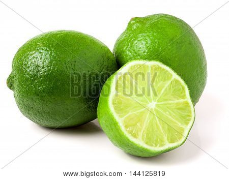 two limes with half isolated on white background.