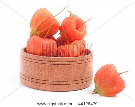 husk tomatoes in wooden bowl isolated on white background.