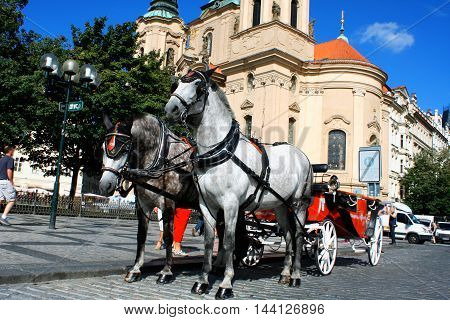 Prague - town square with horses for turistic ride and St. Nicholas