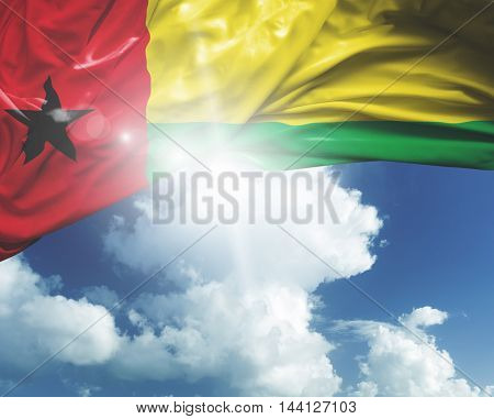 Guinea-Bissau flag on a beautiful day
