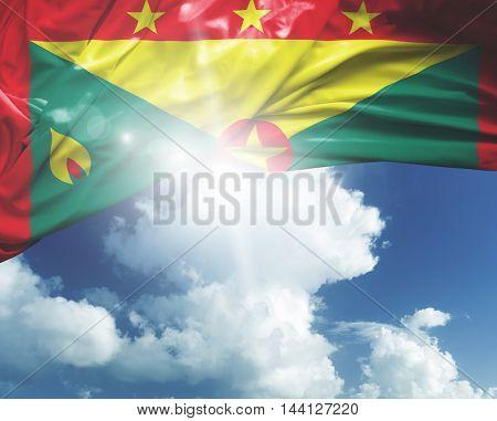 Grenada flag on a beautiful day