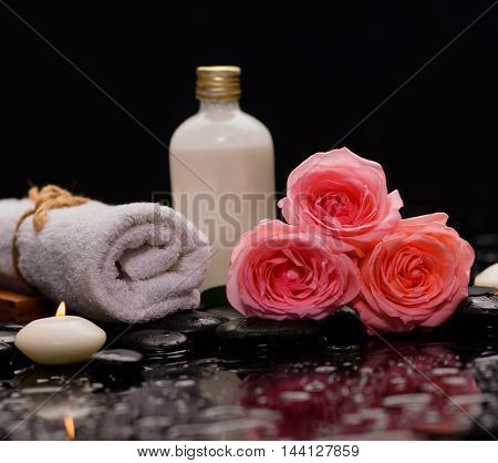 rose with candle ,towel ,oil and therapy stones