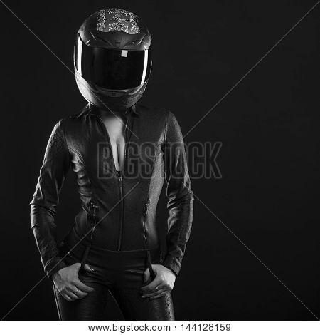 biker girl posing in studio in black background