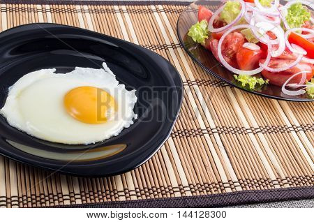 Natural Homemade Breakfast Of Fried Egg And Salad