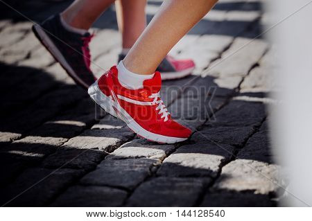 closeup of red sports shoes running on athlete foot