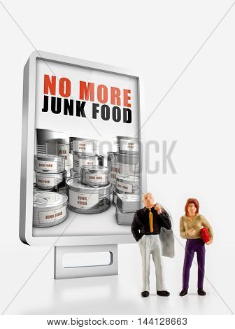 people in front a billboard about junk food