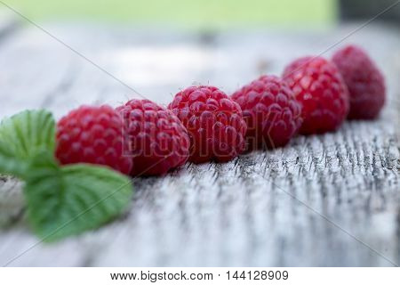 Fresh Organic Berries. Raspberries On Old Wooden Table