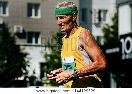 Ekaterinburg Russia - August 7 2016: closeup of old man runner watch on his arm during Marathon Europe-Asia