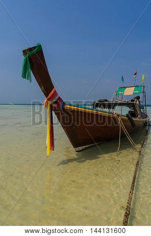 old style boat on the beach and blue sky