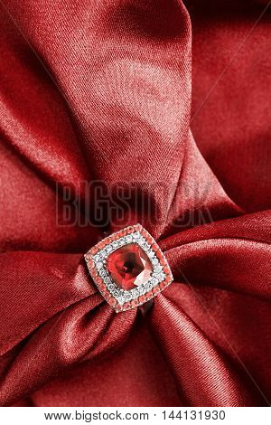 Ruby ring on draped red satin as a background